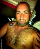 blue eyed hairy bear tats arm tattoed gay dude.jpg