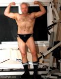 husky gay bear flexing his arms.jpg