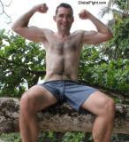 well built toned slender gay man flexed arms.jpg