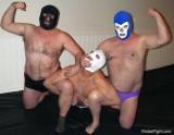gay men grouped together wrestling roughhousing.jpg