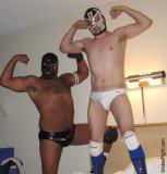pro wrestlers hotel wrestling guys flexing on bed.jpg
