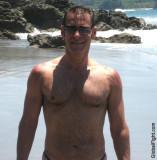 hunky tanned beach men walking wet muscledude.jpg