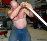 man working hot garage sweaty shirtless.jpg