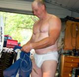 mechanic man removing blue coveralls overalls.jpg