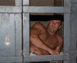 caged man prisoner hairychest shirtless men.jpg