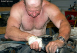 bald mechanic man working shirtless air gun.jpg