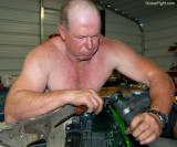 man changing motor oil antifreeze radiator fluid.jpg