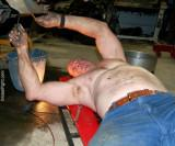 man working on car draining radiator oil fluids.jpg