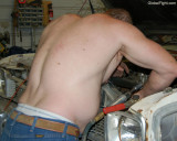 shirtless man working hard home garage.jpg