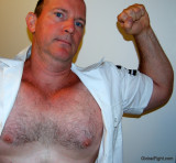 military men flexing arms hairy chests.JPG