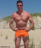 muscleman flexing chest muscles on beach.jpg