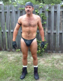 very country leatherman posing backyard dad.jpg