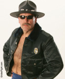 big tough hairychest policeman leather cop.jpg