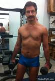 aerobic gay daddy working out gym weights.jpg