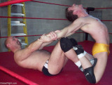 mans outstretched arms pro wrestling videos.jpg