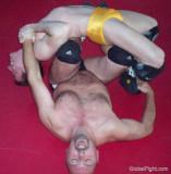 men straddling backbreaker holds wrestling vids.jpg