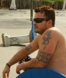 hunks sitting on beach shirtless.jpg