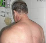 big muscular back man taking shower.jpg