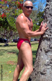 muscle man posing showingoff park.jpg