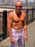 new york muscleman posing boardwalk docks.jpg