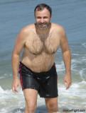 dad soaking wet swimming running ocean.jpg