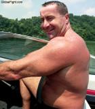 hairy belly man driving boat.jpg