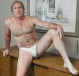 blond bombshell sitting semi nude working desk.JPG