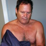 dad putting on his shirt taking off removing.jpg