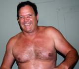 handsome middle aged man smiling shirtless.jpg