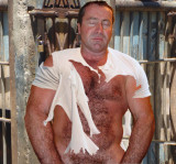 hairy prisoner being tormented ripped shirt.jpg