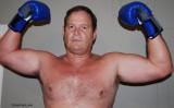 big husky boxer dad wearing gloves.jpg