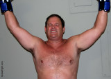 happy boxer man raised arms victorious.jpg