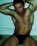 bodybuilder arms raised flexing biceps.JPG