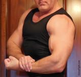 brother flexing tanktop big muscles.jpg