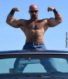 goatee leather muscleman flexing hard pecs.jpg