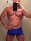 muscle dude wearing gym shorts.jpg