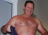big furry chest man removing shirt.jpg