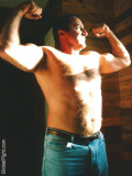 bluejeans man shirtless flexed muscles.jpg