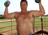 dad lifting weights ranch mans farm.jpg