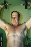 hotel room gym man lifting weights.jpg