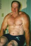 man holding himself up muscle training.jpg