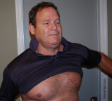 man pulling off shirt removing clothes.jpg