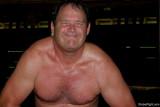 older male bodybuilder flexing lats hairychest.jpg