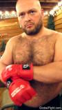 hairybear putting on boxing gloves burly man.jpg