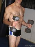 hairy muscleguy lifting weights.jpg