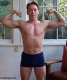 muscle boyz flexing hard ripped biceps abdominals.jpg