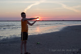 Timo holding the sun