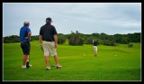 Mark tees off under the watch of our two pro's Colin and Eric