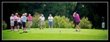 Lister tees off