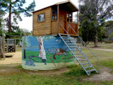 Painted water tank with play house